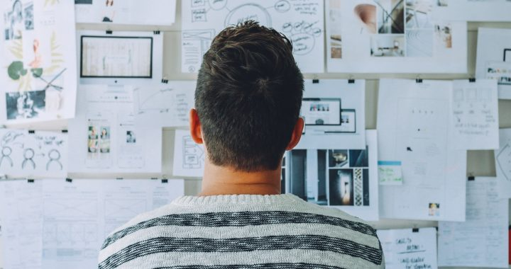 man with plans on wall, the three A's of real estate